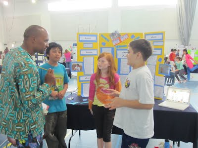ASD students present their experiment to a judge at our annual science fair